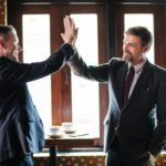Two businessmen celebrating finding the right digital marketing agency