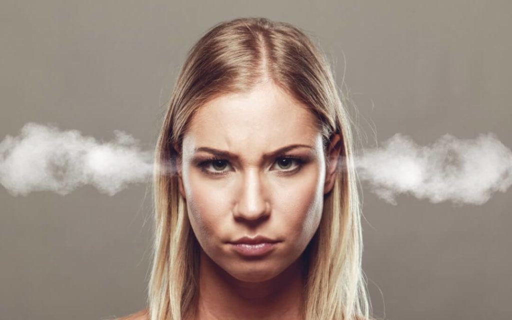 Angry woman with steam coming out of her ears