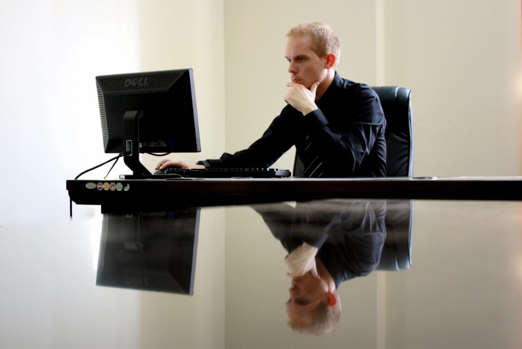 Man using an application on his computer