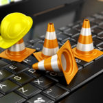 Photo of several tiny traffic cones blocking access to a computer keyboard
